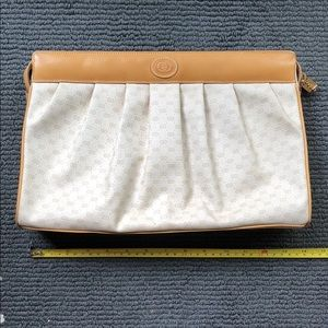 Gucci cream and tan clutch